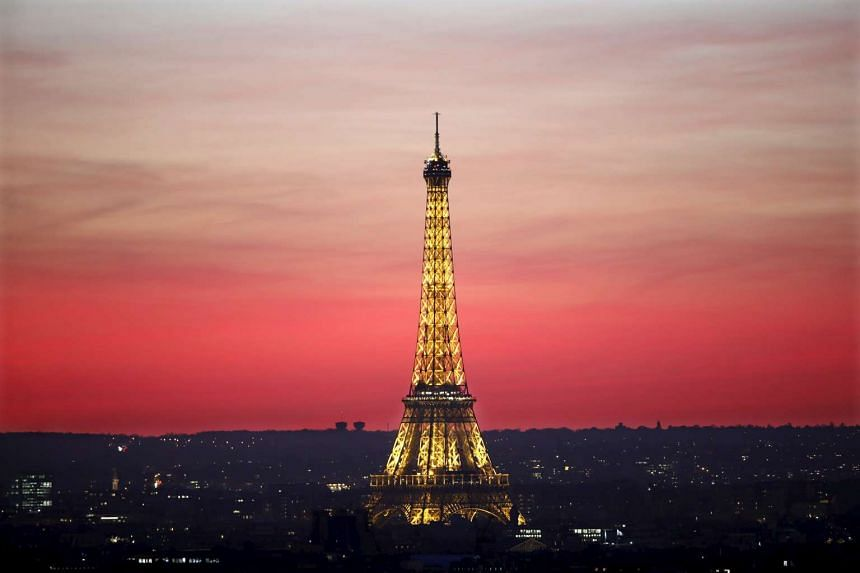 The Eiffel Tower is seen at sunset in Paris, France, on Nov 9, 2015. The capital will host the World Climate Change Conference 2015 from Nov 30 to Dec 11, 2015.