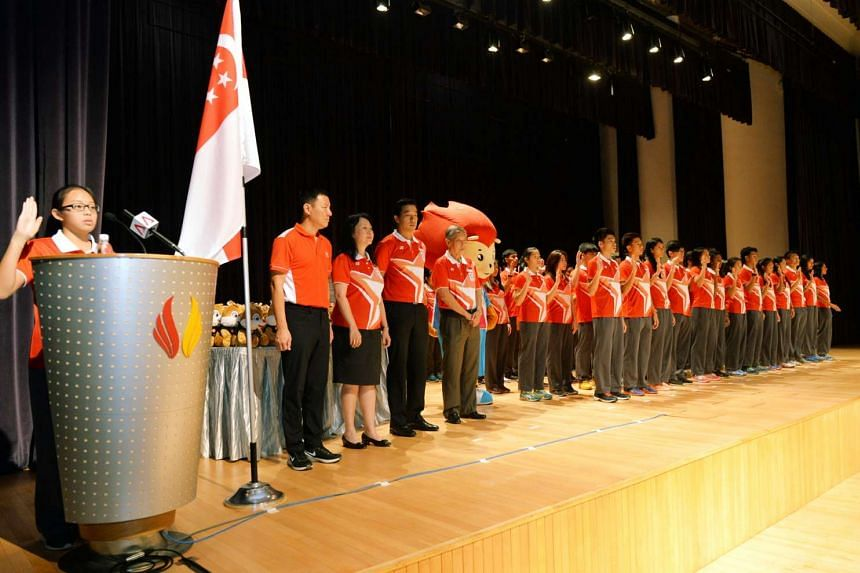 Students and alumni of the Singapore Sports School taking the national pledge during the SEA Games send-off on May 27, 2015.