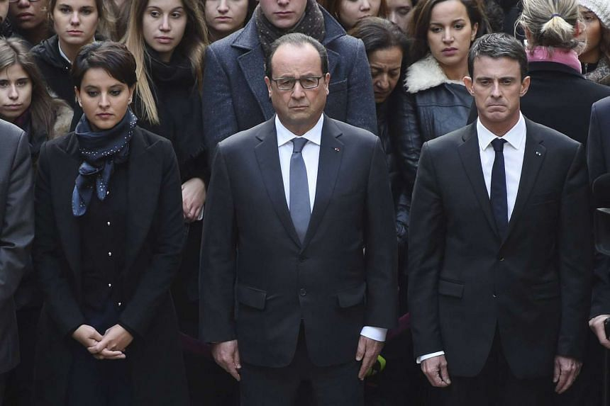 (From left) French Education Minister Najat Vallaud-Belkacem, French President Francois Hollande and French Prime Minister Manuel Valls observe a minute of silence at the Sorbonne University in Paris to pay tribute to victims of Friday's Paris attack