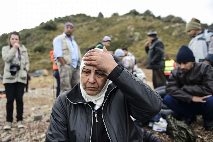 Syrian refugees on the Greek island of Lesbos after crossing the Aegean Sea from Turkey on Nov 16, 2015.