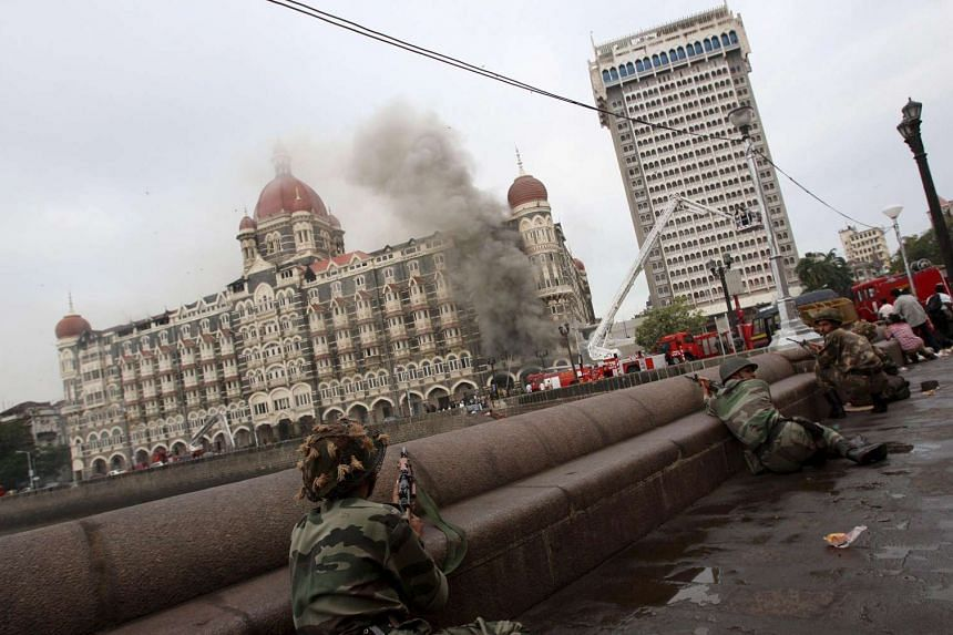 Smoke billows from the Taj hotel as firing continues between the terrorists and security personnel in Mumbai on Nov 29, 2008.