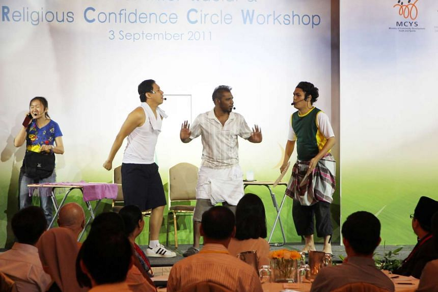 Performers acting out a scene from a skit during the National Inter-Racial & Religious Confidence Circle Workshop in 2011.