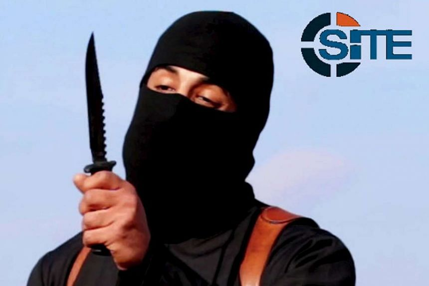 A masked, black-clad militant, who has been identified by the Washington Post newspaper as a Briton named Mohammed Emwazi, brandishes a knife in this still file image from a 2014 video obtained from SITE Intel Group on Feb 26, 2015.