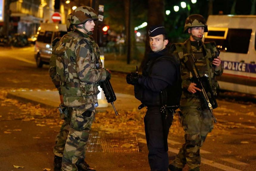 French security personnel near the Bataclan concert venue in Paris on Nov 15, 2015.