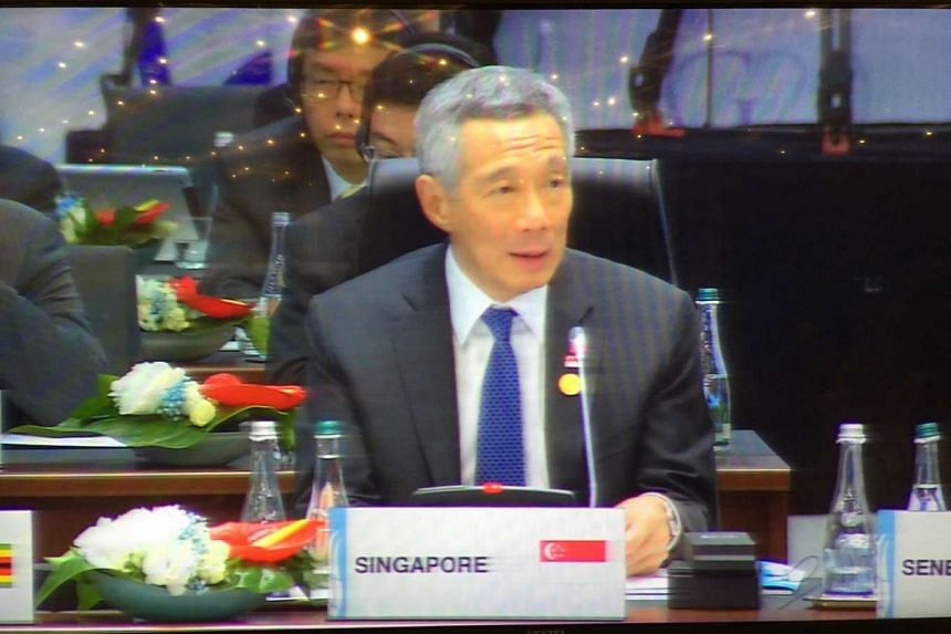 Prime Minister Lee Hsien Loong speaking at a working session on the global economy and growth strategies at the G-20 Leaders' Summit on Sunday.