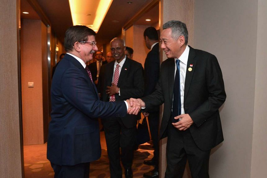 Singapore Prime Minister Lee Hsien Loong and Turkish Prime Minister Ahmet Davutoglu meeting at the G-20 summit in Antalya on Sunday.