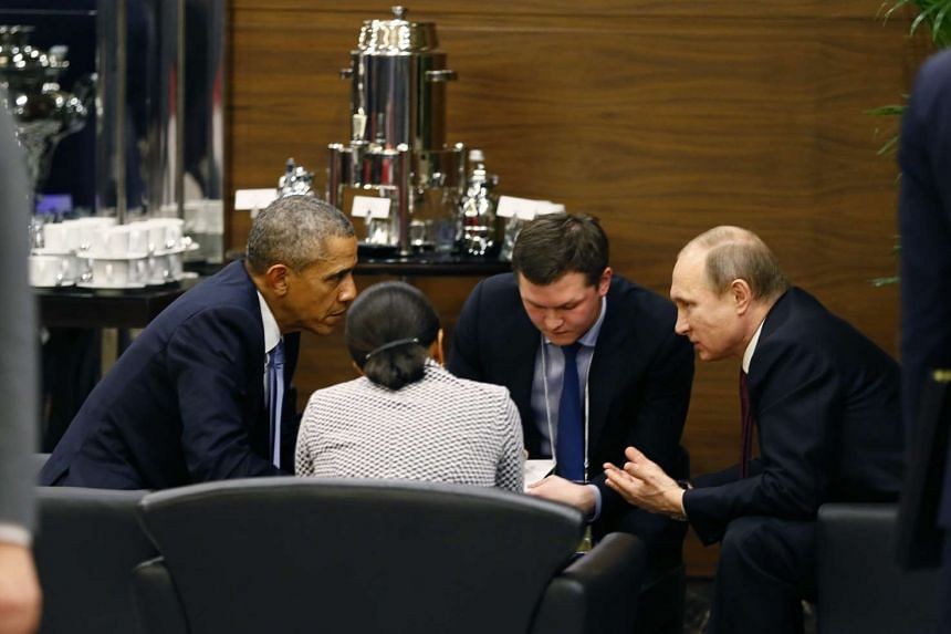 US President Barack Obama (left) talks to Russian counterpart Vladimir Putin (right) during a break of the G20 summit working session in Antalya, Turkey on Sunday.