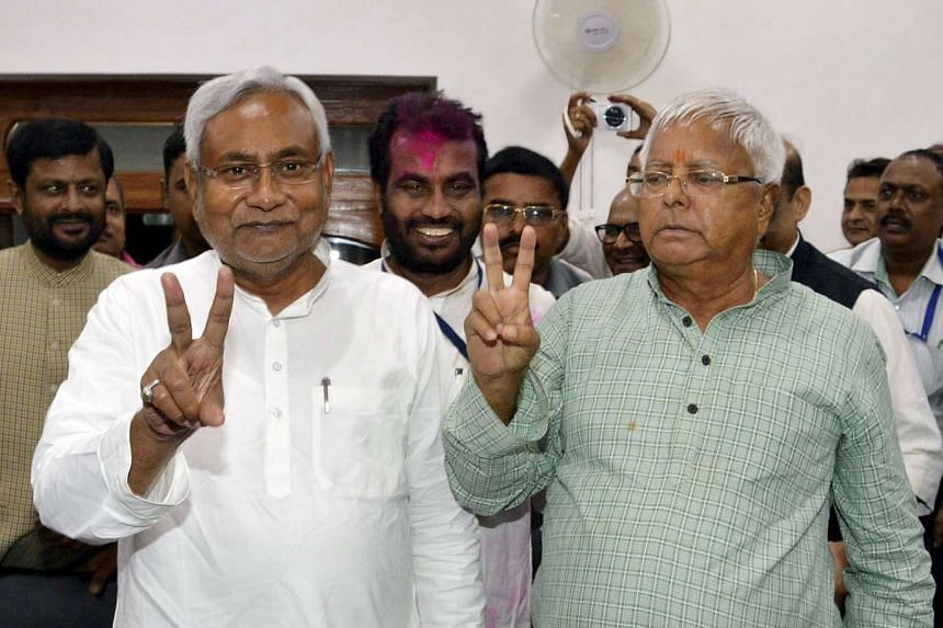 Mr Nitish Kumar (left, in white), leader of Janata Dal (United), and Mr Lalu Prasad Yadav (beside him), chief of Rashtriya Janata Dal, after their alliance won 178 out of 243 seats in the Bihar state assembly elections. Many attributed their win to t