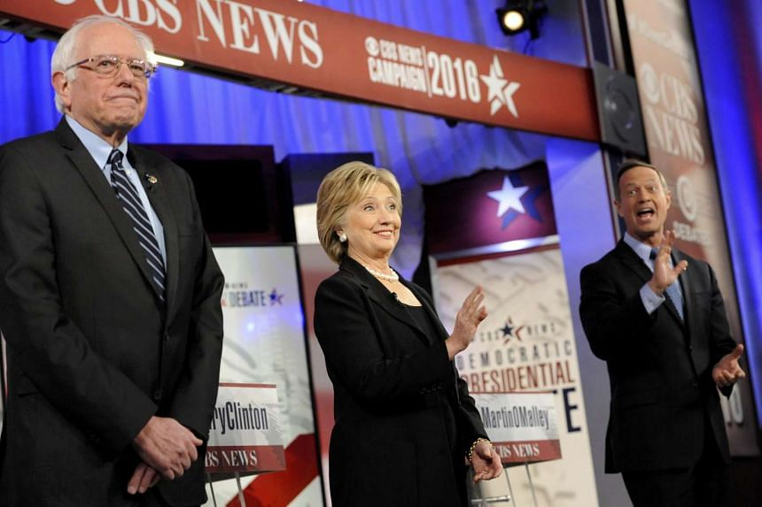 Democratic presidential candidates (from left) Bernie Sanders, Hillary Clinton and Martin O'Malley spoke of a resilient America at the Democratic debate in Des Moines last weekend.