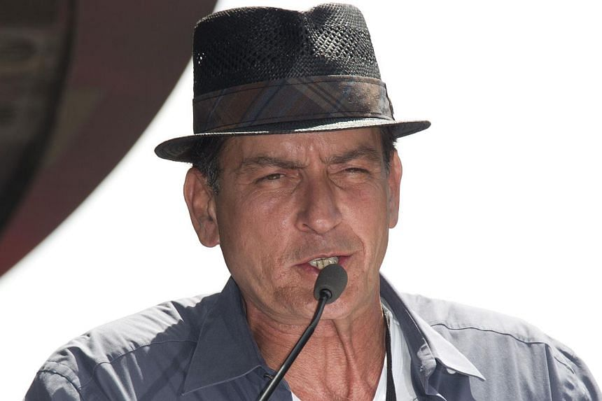 Charlie Sheen speaking during a star ceremony for British-American musician and songwriter Slash on July 10, 2012.