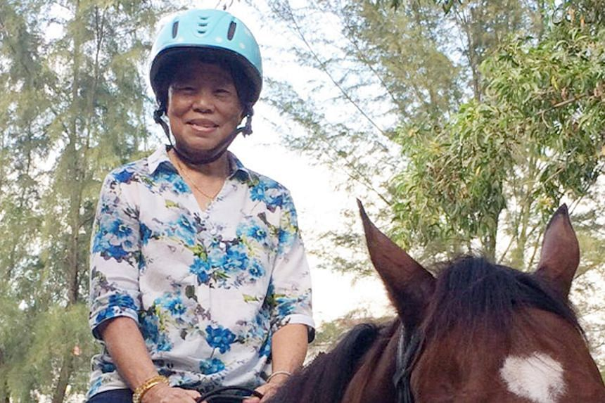 It was Madam Lim Ah Boey's first time in the saddle.