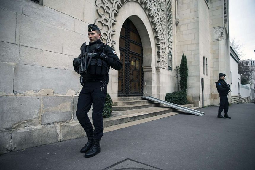 French officers of the gendarmery guard the entrance of the Great Mosque of Paris.