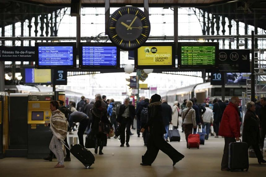 Commuters and travellers walks through the Gare du Nord railway station on Nov 16, 2015 in Paris.