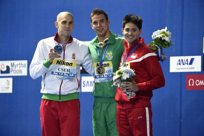 Joseph Schooling (right) posing with Hungary's Laszlo Cseh (right) and South Africa's Chad le Clos in Kazan, Russia.