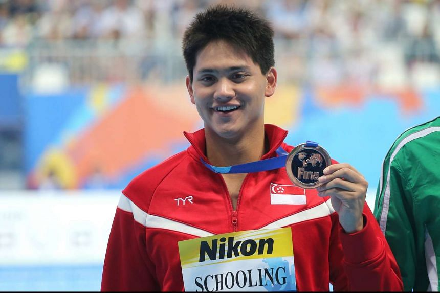 Singapore swimmer Joseph Schooling showing off his bronze medal after the men's 100m butterfly at the Fina World Championships in Kazan, Russia, on Aug 8, 2015.