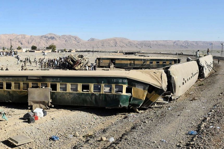 A view of derailed wagons of a passenger train in Bolan district of Balochistan province, Pakistan on Nov 17, 2015.