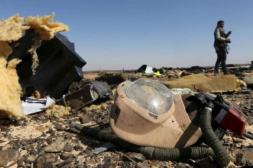 Debris from a Russian airliner is seen at its crash site at the Hassana area in Arish city, Egypt, Nov 1, 2015.