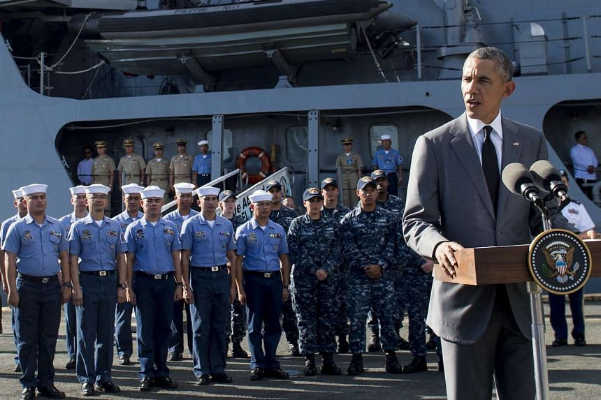 US President Barack Obama (right) speaks following a tour of the BRP Gregario Del Pilar in Manila Harbor in Manila on Nov 17, 2015.