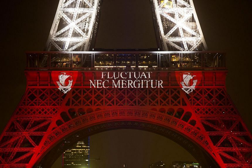 "The illumination included the defiant Latin slogan of Paris, ""Fluctuat nec mergitur"" meaning ""It is buffeted by the waves, yet remains afloat."""