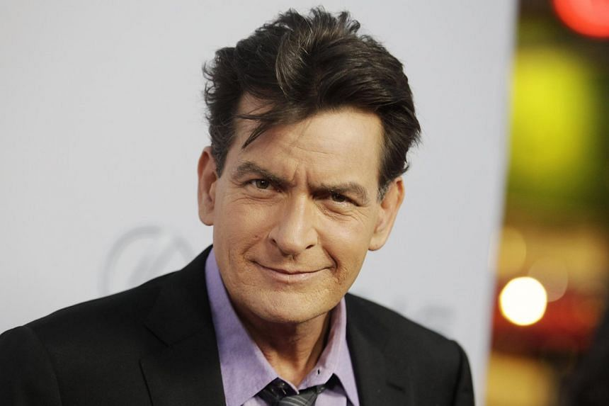 Charlie Sheen poses at the premiere of the film Scary Movie 5 in Hollywood.