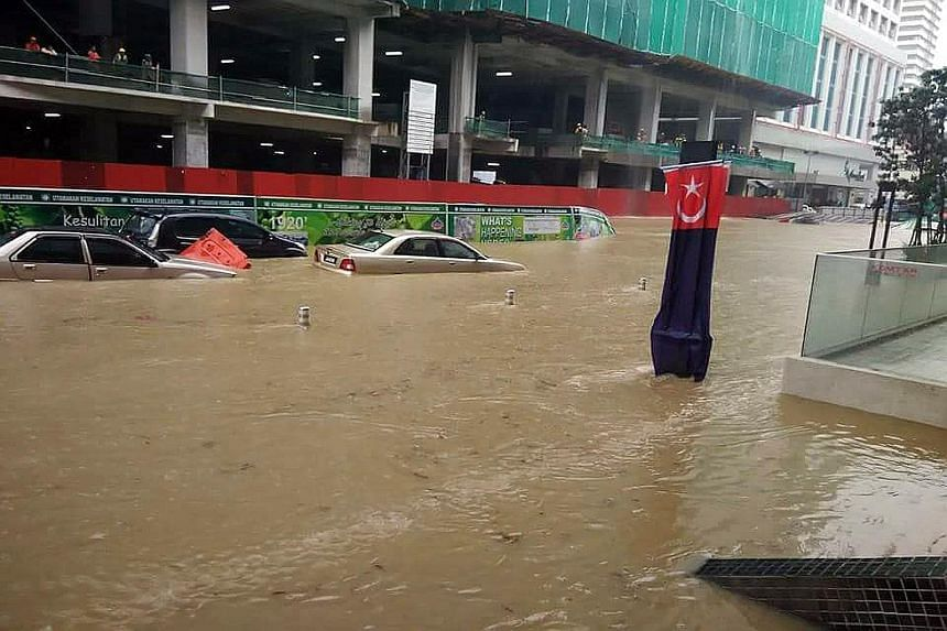 Dozens of cars were trapped in the deluge, while some shops in the lower levels of the city centre were flooded. The City Square Johor Baru shopping complex and Komtar JBCC were among those affected.
