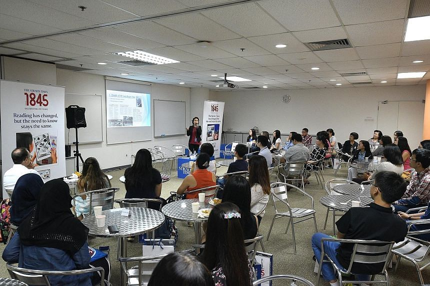 Forum editor Liaw Wy-Cin speaking at the ST Young Forum Writers dialogue yesterday at SPH News Centre in Toa Payoh. She encouraged the more than 20 young letter writers gathered to ask their peers to read the Home section first, where they might find