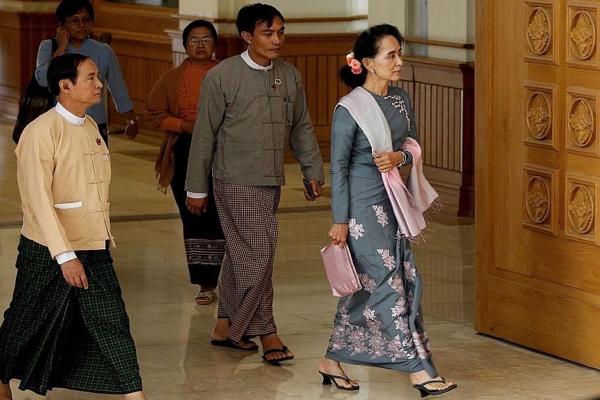 Military representatives arriving for a session of the Parliament in Naypyitaw, Myanmar, yesterday. Even though the National League for Democracy party has won the recent election, the powerful military still has a constitutionally guaranteed 25 per