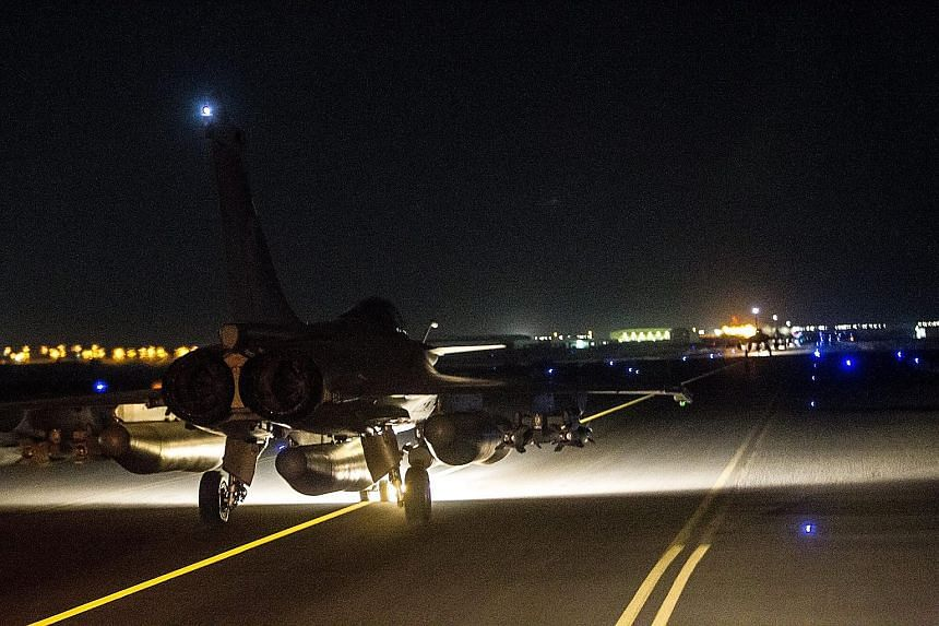 """This photograph issued by the French Defence Ministry shows a fighter jet taking off from a base in the Gulf. The French air strikes on Raqqa, which began at 7.50pm Paris time on Sunday, were aimed at an ISIS """"command post, jihadist recruitment centr"""