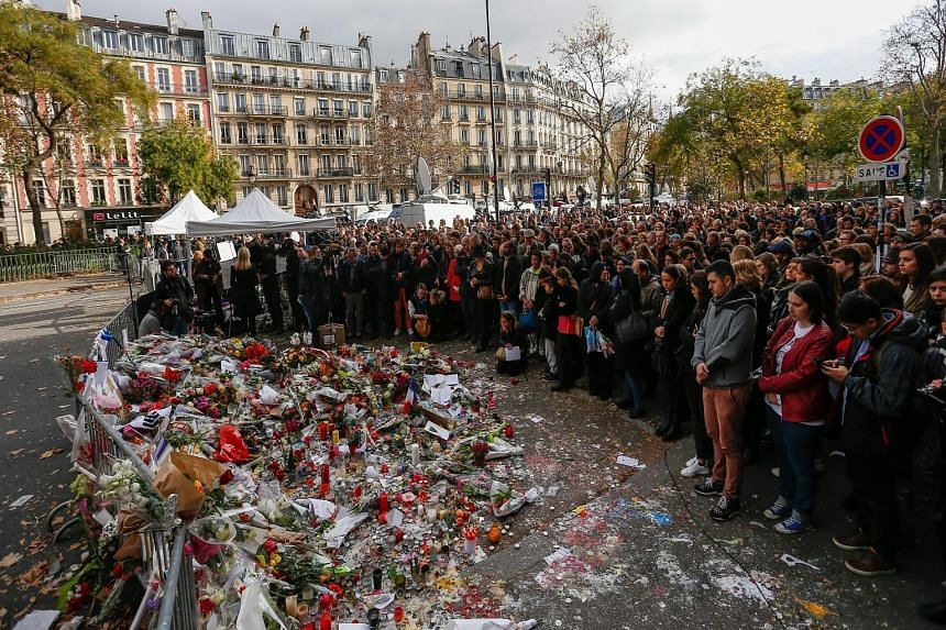 Outside the Bataclan concert hall in Paris. Leaders at the working session of the G-20 meeting in Antalya, Turkey. A vigil in Melbourne. The Euro 2016 qualifier between Hungary and Norway, in Budapest. At the French Embassy in Singapore.