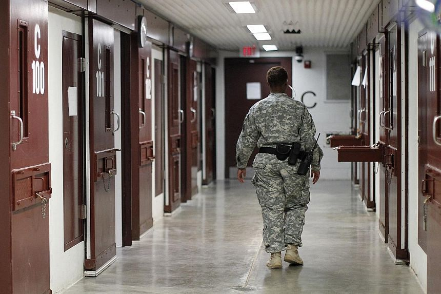 A guard at the US Guantanamo Bay prison camp. The Obama administration is expected to send Congress a plan soon to close the Guantanamo prison, including moving 59 detainees, who are not recommended for transfer, to a US jail.