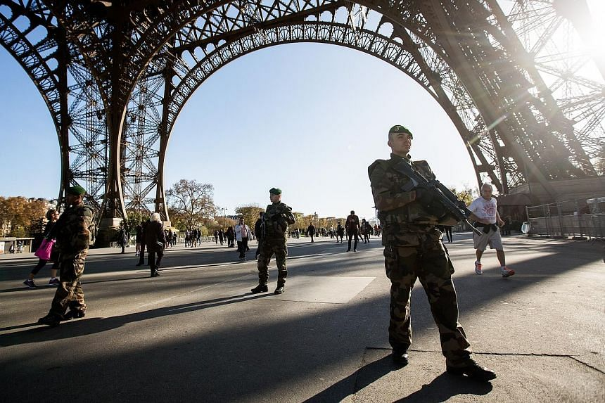 Morrocan Ayoub El Khazzani and Frenchman Mehdi Nemmouche are said to have links to the Belgian town of Molenbeek. (Above) Soldiers patrolling the Eiffel Tower in Paris on Sunday as the search goes on for terrorists. (Left) A picture from the February