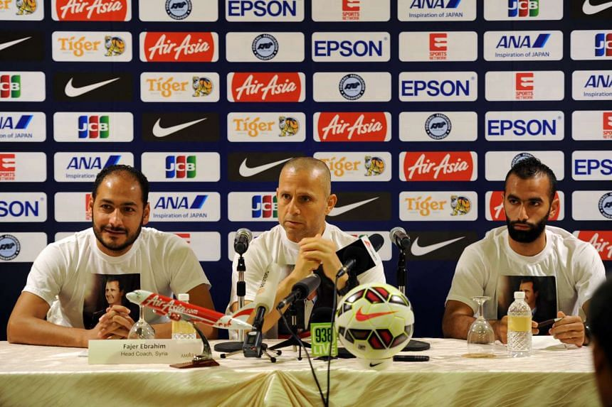 A Syrian player and officials at a pre-match press conference at the Amara Hotel on Nov 16.