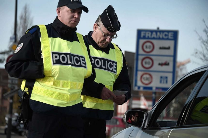 """French Police officers carrying out checks on vehicles on the """"European bridge"""" between Strasbourg and Kehl on Nov 14, 2015, in the aftermath of the Paris attacks."""
