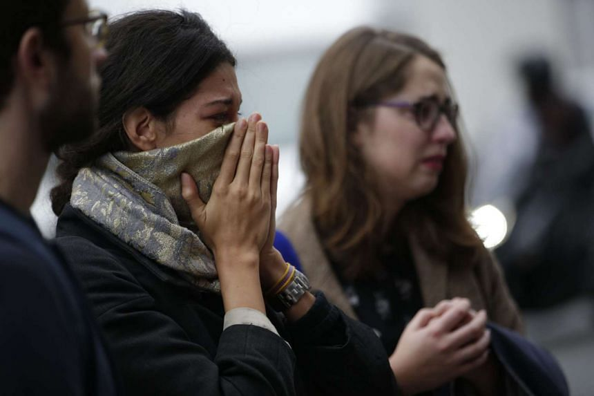 People mourning at the Cafe Belle Equipe on Nov 16 in Paris.