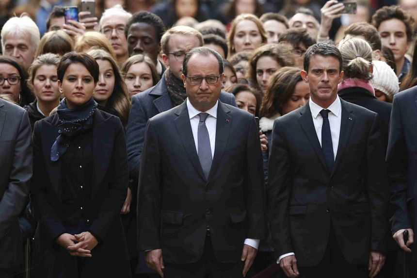 French President Francois Hollande (centre), flanked by Education Minister Najat Vallaud-Belkacem (left) and Prime Minister Manuel Valls (right), observing a minute of silence at the Sorbonne University in Paris on Nov 16.