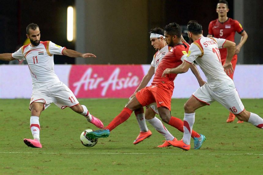 Singapore's Hariss Harun making a tackle during the Fifa World Cup qualifying match against Syria at the National Stadium on Nov 17, 2015.
