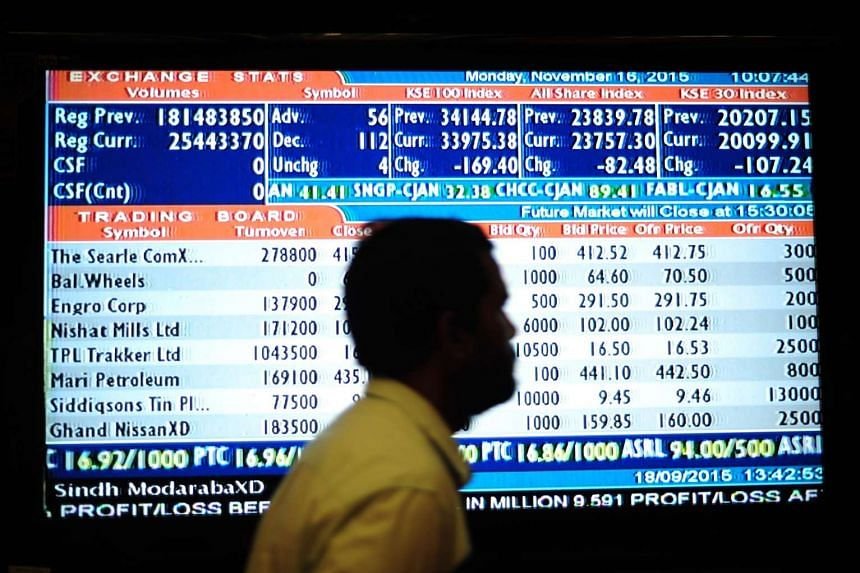 A Pakistani stockbroker watching share prices during trading at the Karachi Stock Exchange on Nov 16, 2015.