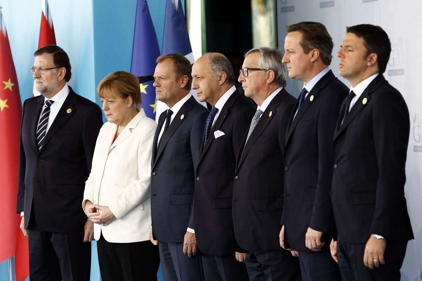 From left to right: Spanish Prime Minister Mariano Rajoy, German Chancellor Angela Merkel, President of the European Council Donald Tusk, French Foreign Minister Laurent Fabius, European Commission President Jean-Claude Juncker, British Prime Ministe