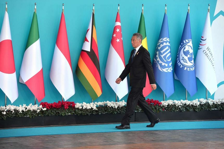 PM Lee Hsien Loong passes flags at the G20 Summit venue in Antalya, Turkey.