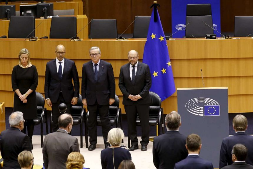 (From left) European Union foreign policy chief Federica Mogherini, French State Secretary for European Affairs Harlem Desir, European Commission President Jean-Claude Juncker and European Parliament President Martin Schulz observing a minute of sile