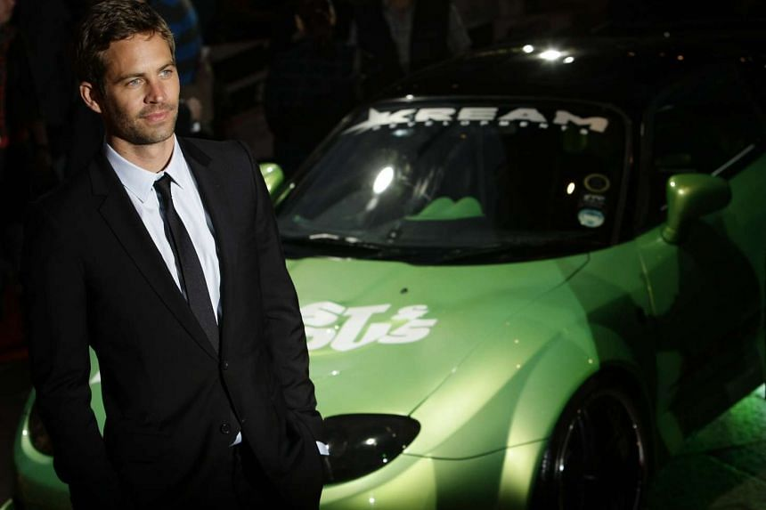 "Actor Paul Walker arriving for the British premiere of ""Fast & Furious"" in Leicester Square in London, in this file photo taken on March 19, 2009. The daughter of late actor Walker filed a wrongful death lawsuit against automaker, Porsche, claiming i"