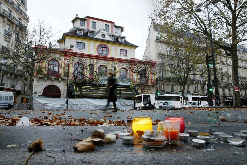 A woman walking past the Bataclan theatre in Paris where 89 people were killed.