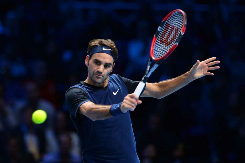 Roger Federer returning the ball to Novak Djokovic (not pictured) at the ATP World Tour Finals tennis tournament on Nov 17, 2015.