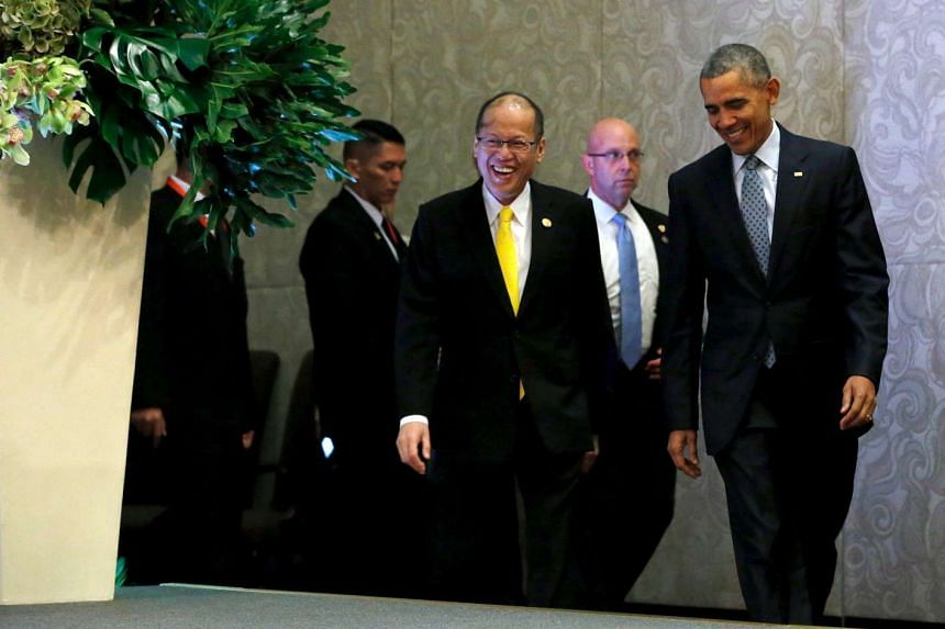 Philippine's President Benigno Aquino and US President Barack Obama arriving for a news conference after their meeting alongside the Apec summit in Manila, Philippines, on Nov 18, 2015.