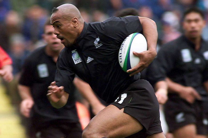 Jonah Lomu on his way to scoring the All Black's first try against Tonga during their Rugby World Cup Group B match in 1999.