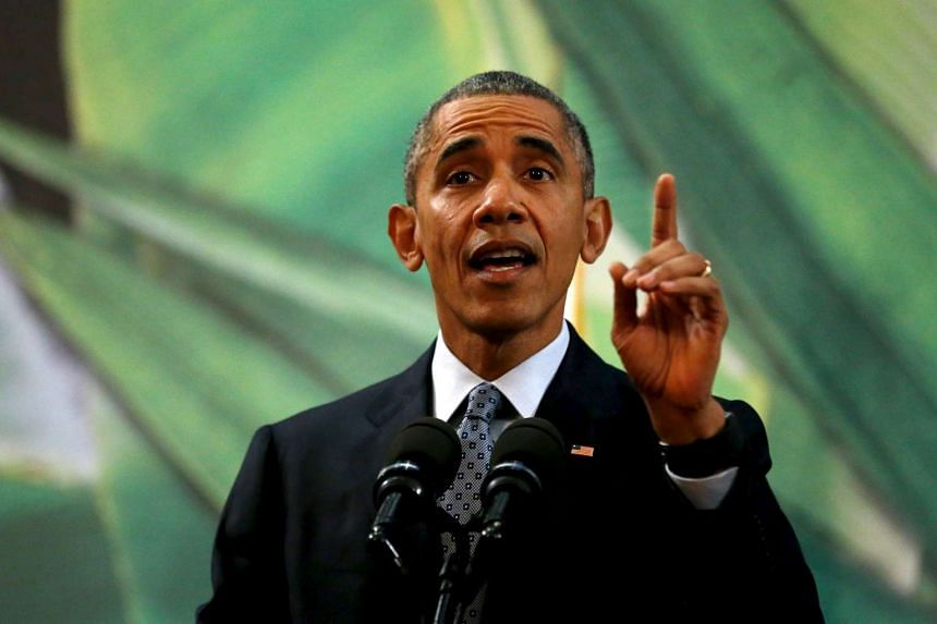 US President Barack Obama gestures while reacting to a question about US politicians opposed to taking in Syrian refugees as he delivers remarks after meeting with the Philippines President Benigno Aquino alongside the Apec summit in Manila, Philippi