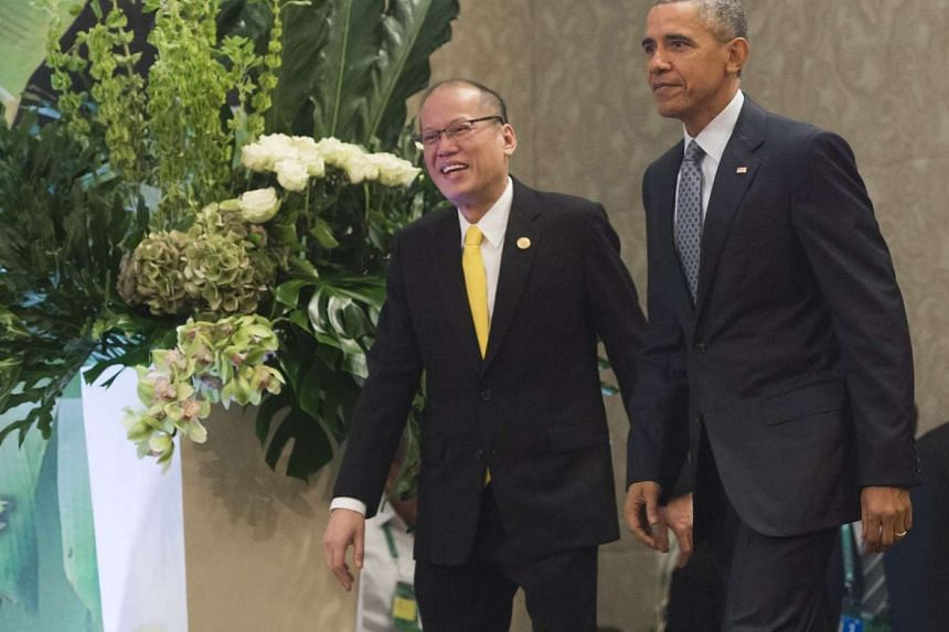 Philippine President Benigno Aquino and US President Barack Obama arrive to speak to the press following a meeting prior to the start of the Asia-Pacific Economic Cooperation (Apec) Summit in Manila on November 18, 2015.