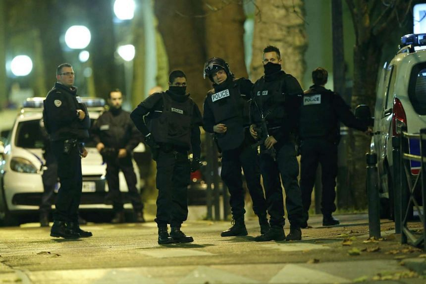 French special police forces secure the area as shots are exchanged in Saint-Denis, France, near Paris, on Nov 18, 2015 during an operation to catch fugitives from Friday night's deadly attacks in the French capital.