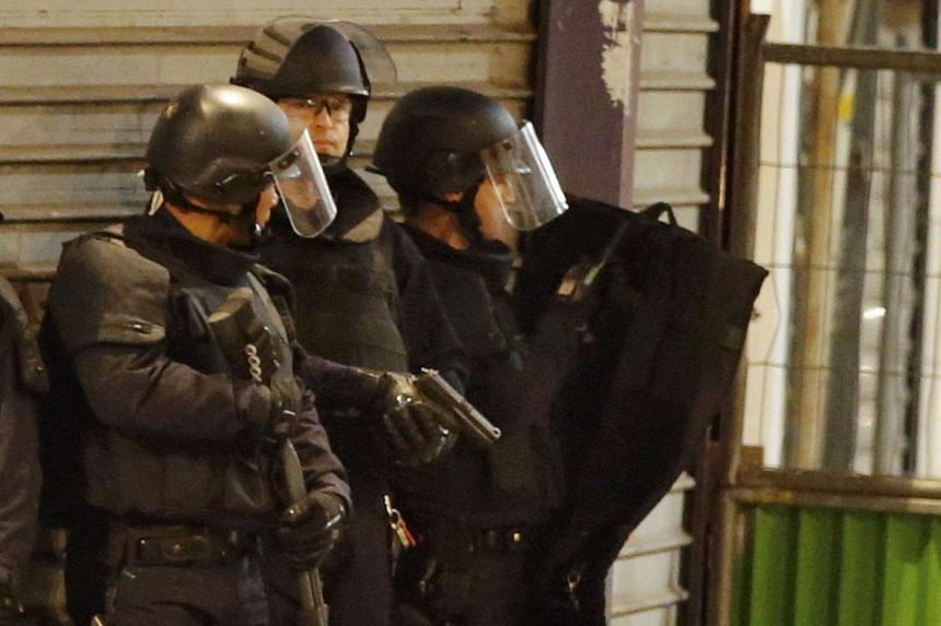 French special police forces secure the area as shots are exchanged in Saint-Denis, near Paris on Nov 18, 2015.