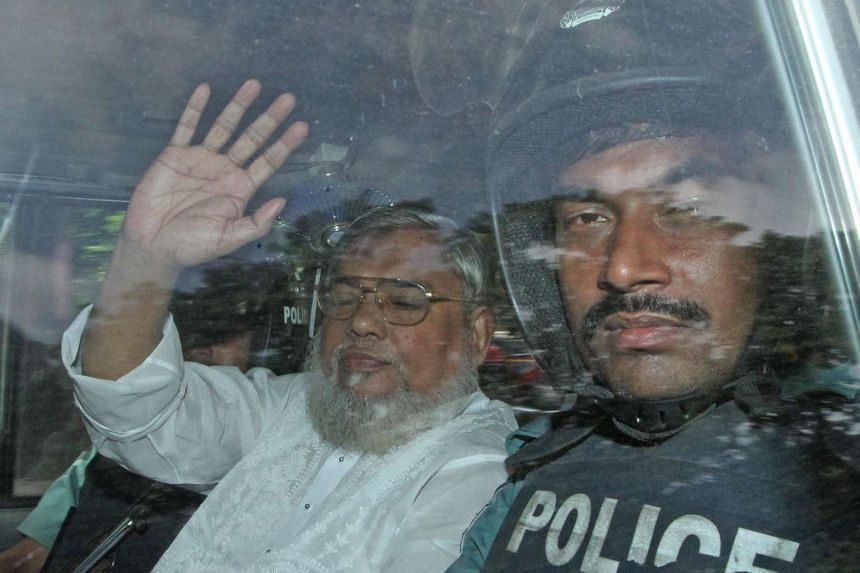 A file picture taken on July 17, 2013 shows Secretary General of Jamaat e Islam, Ali Ahsan Mohammad Mujahid waving from a police vehicle as he is transported to the central jail after a court verdict in Dhaka. Bangladesh's highest court on November 1